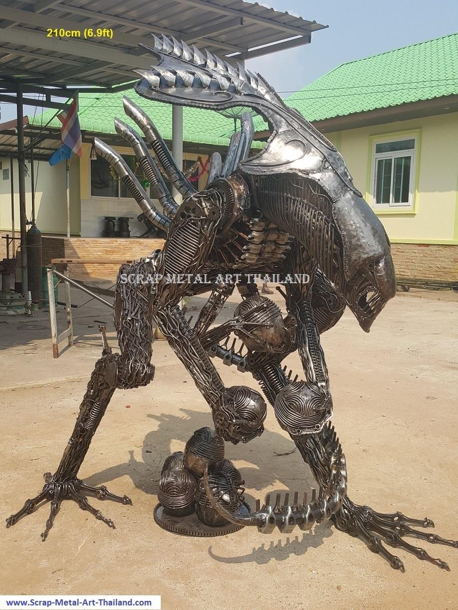 alien queen sculpture, protecting her eggs, lifesize scrap metal art