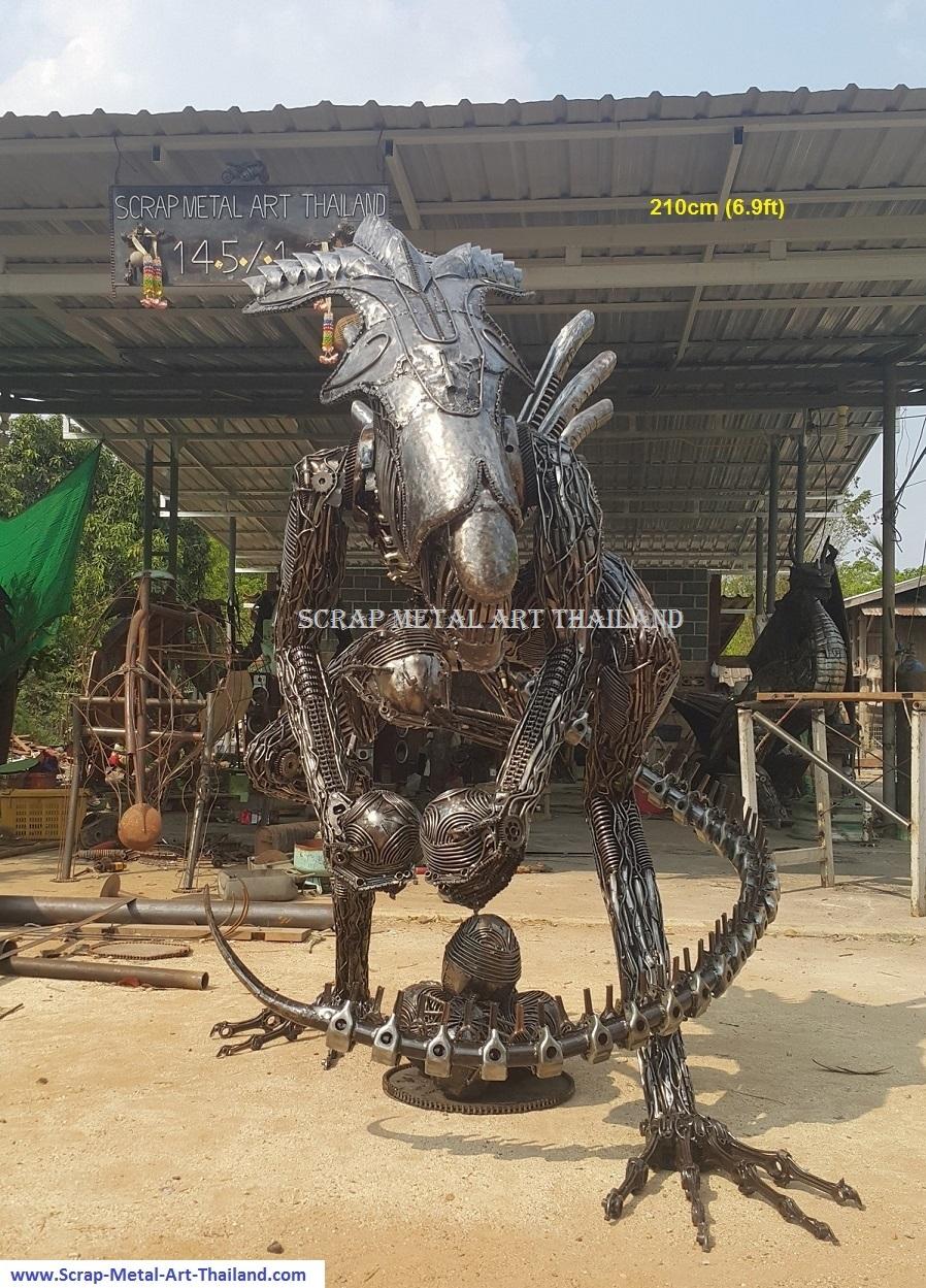 alien queen statue, protecting her eggs, lifesize scrap metal art