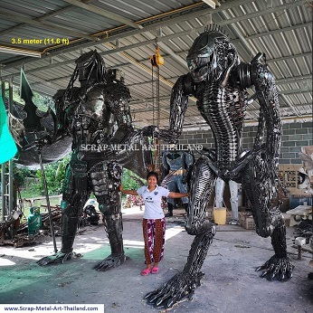 Giant Alien vs Predator statues, recycled metal figures made in Thailand