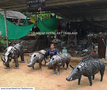 baby rhino statues, and life size wild boar sculpture, with the 13 Tham Luang cave boys, scrap metal art made in Thailand
