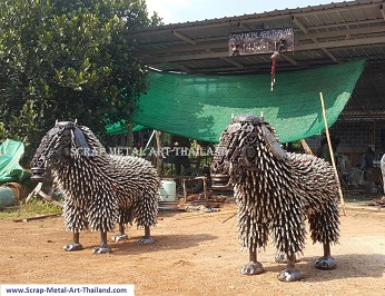 sheep statues, twins, scrap metal animal art, life size (made from spark plugs)
